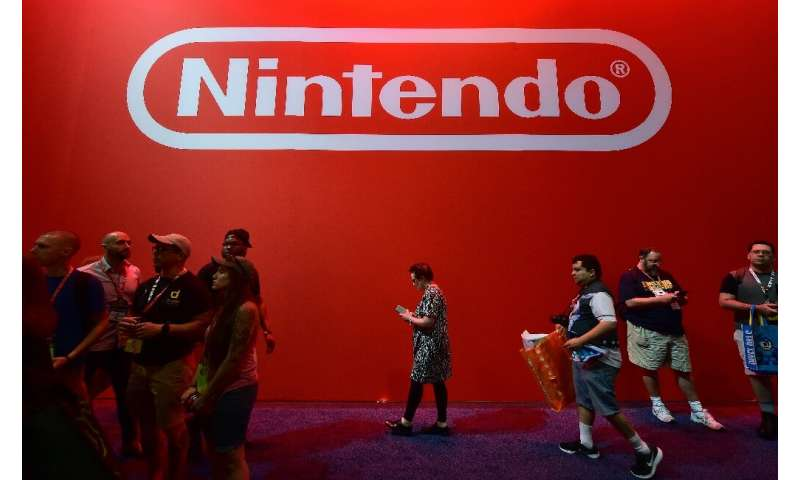 "Nintendo said net profit shrank ""as a result of foreign exchange losses of 12 billion yen and other factors"""