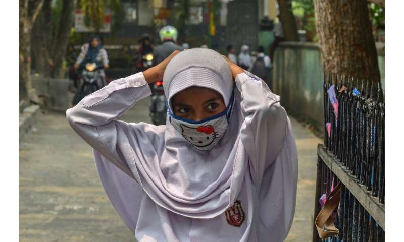 People have been told to wear face masks to protect them from the smog