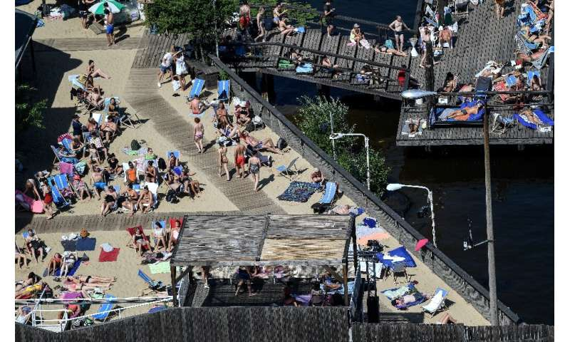 People in Berlin took to a beach at a public pool on the river Spree to try and cool off
