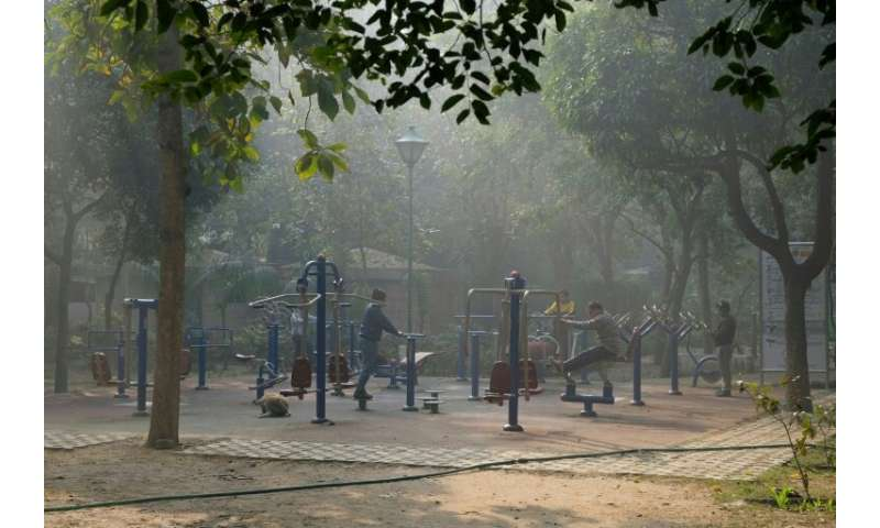 People still exercise on a morning of heavy air pollution at Lodhi Gardens in New Delhi