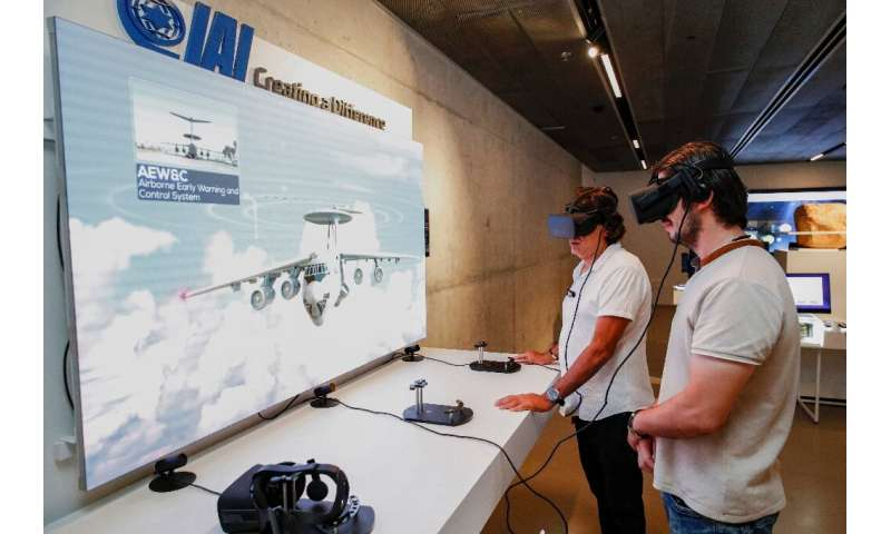 People visit displays of Israeli technology at the Peres Center for Peace and Innovation in the coastal city of Tel Aviv