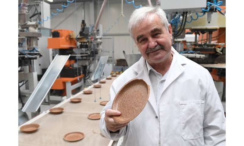Polish inventor and entrepreneur Jerzy Wysocki holds a wheat bran plate he invented 15 years ago at the Biotrem factory in Zambr