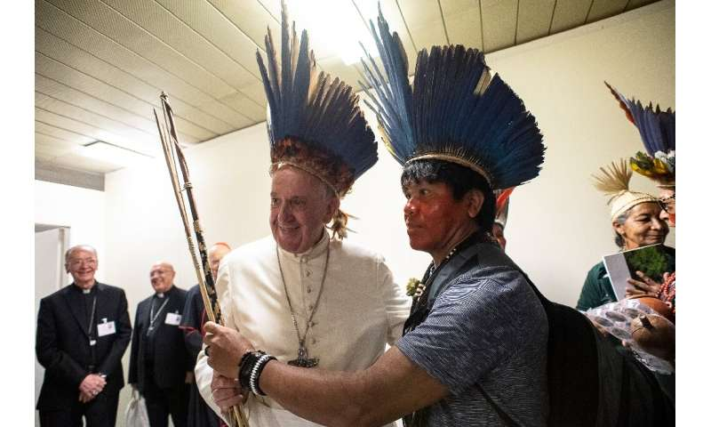 Pope Francis (L) is hosting the special three-week assembly of Catholic bishops on the Pan-Amazonian region