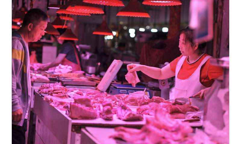 Pork prices in China have soared as pig herds are culled or die from swine flu