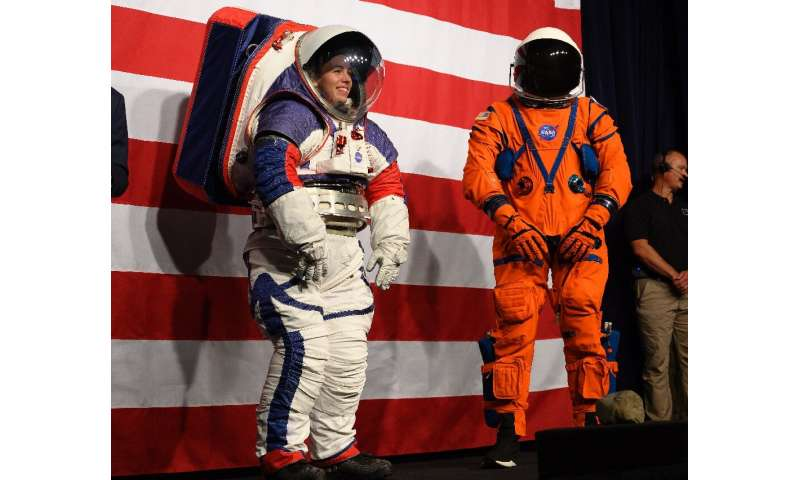 Prototypes of the Orion Crew Survival Suit (R), which will be worn on the way to the Moon, and the Exploration Extravehicular Mo