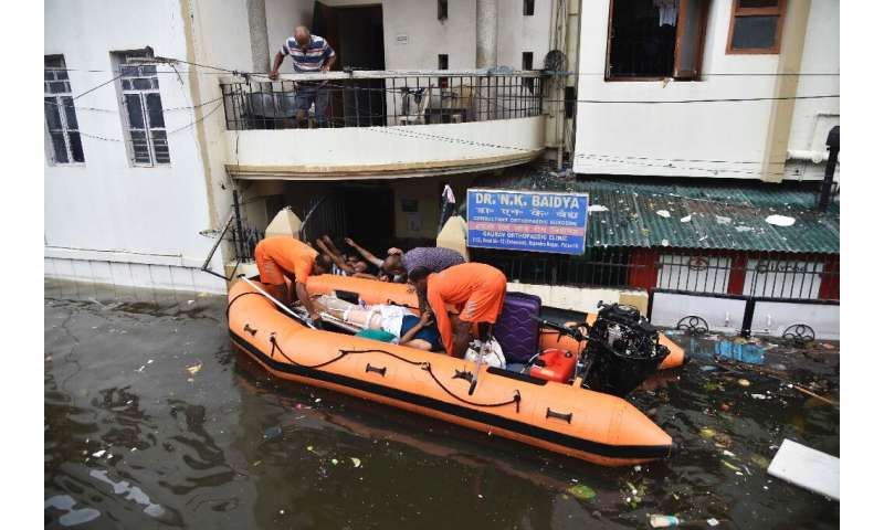 Rainwater swamped hospital wards and residential areas where disaster management officials delivered vital supplies
