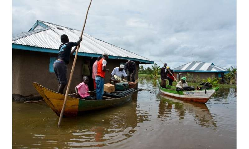 Rescue boats evacuate families after their houses were flooded in Kenya