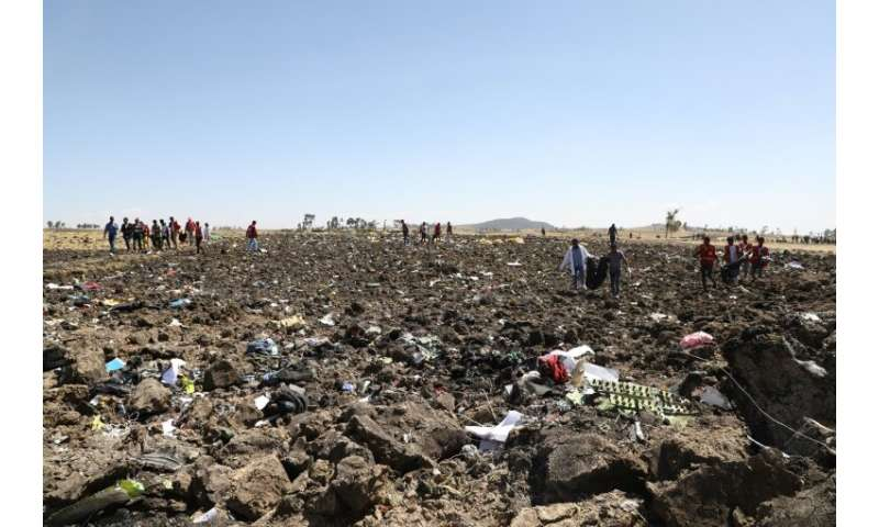 Rescue teams search for the remains of victims of the Ethiopian Airlines crash—the doomed jet was a Boeing 737 MAX