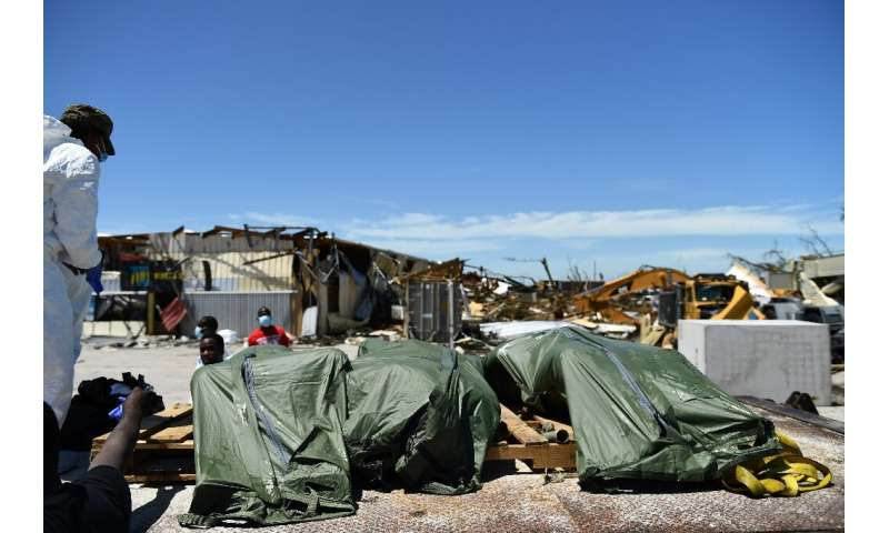 Rescue workers recover the bodies of a victims of Hurricane Dorian in Marsh Harbour, Great Abaco Island in the Bahamas