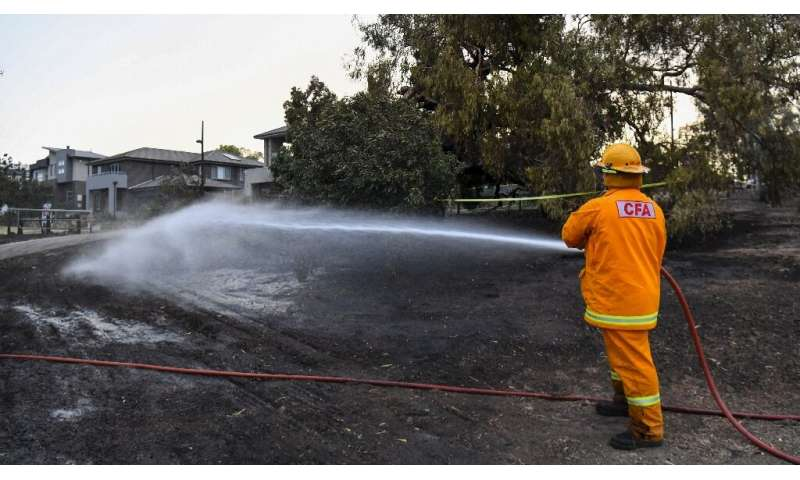Residents and firefighters have been hosing down homes and land to stop the fires from spreading