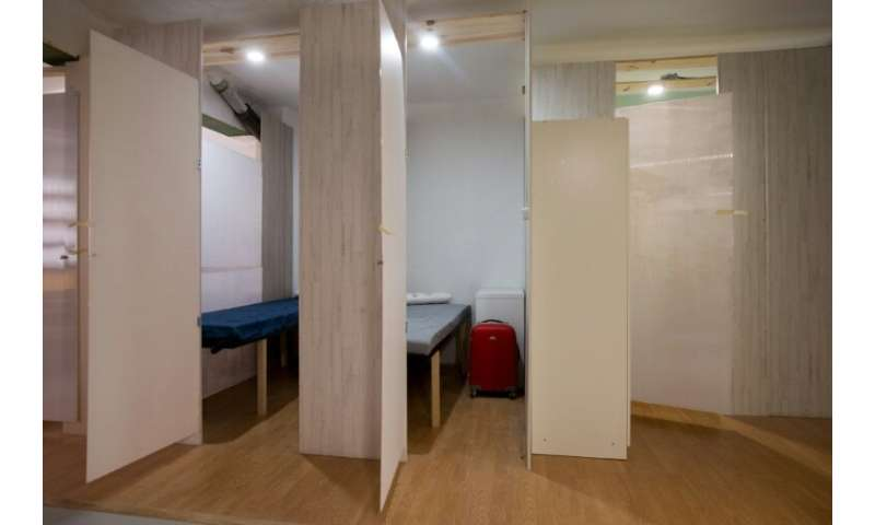 Residents are housed side by side in a building with a shared kitchen, bathroom and terrace—all for around 200 euros ($225) a mo