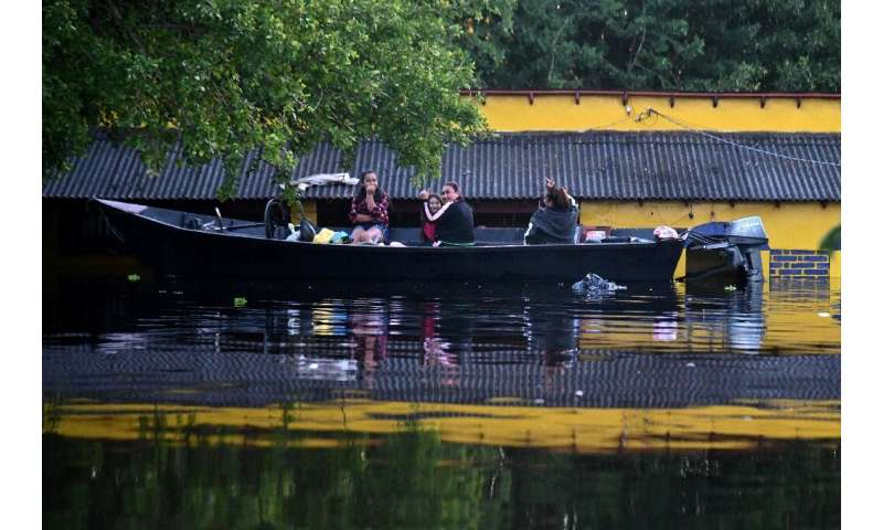 Residents of Nanawa, over the river from Paraguay's capital Asuncion, have to move around by boat in their home town