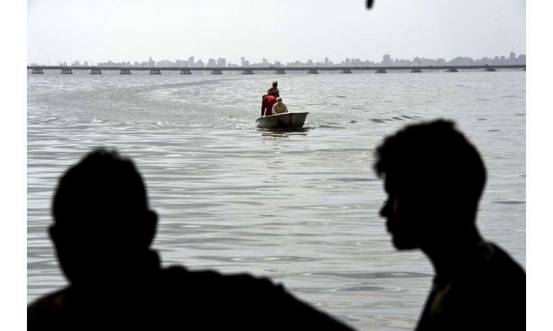 Residents return after fishing in the polluted waters of Lake Maracaibo, Venezuela, on June 13, 2019