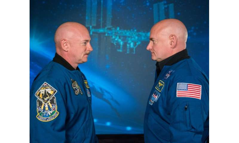 Retired astronaut Scott Kelly, who spent a year on the International Space Station, is pictured on the right, opposite his ident