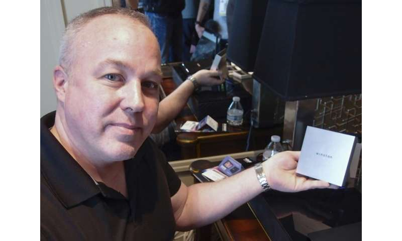 Richard Stokes, CEO and founder of Winston Privacy shows a box containing the Winston online privacy device at the Consumer Elec