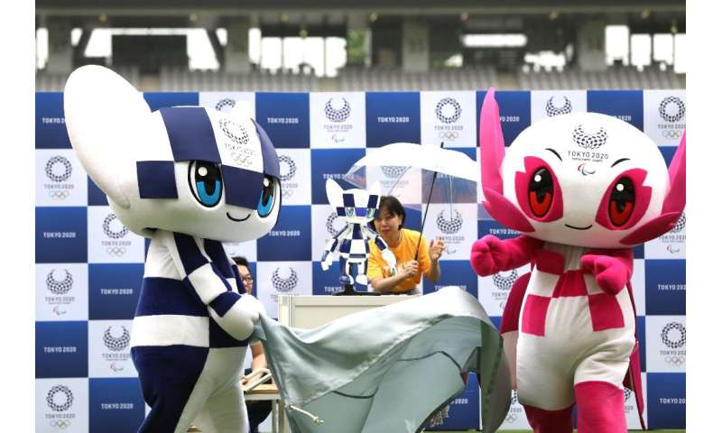 Robotic versions (C) of Tokyo's 2020 Olympic and Paralympic mascots— Miraitowa (left) and Someity—will have cameras inside their