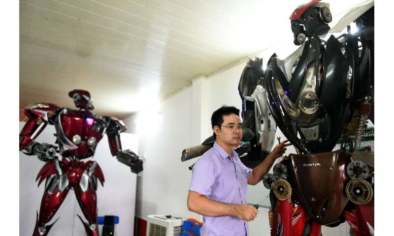 Robot One (L) is just the first of many, the engineers say, with dreams of creating a robot park in Hanoi one day