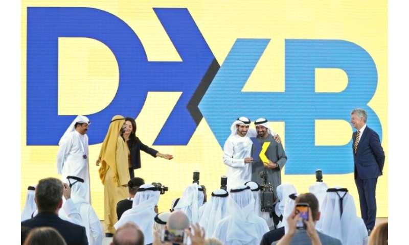 Ruler of Dubai Sheikh Mohammed bin Rashid Al-Maktoum (2-L), and the Emirate's Crown Prince Sheikh Hamdan bin Mohammed bin Rashid