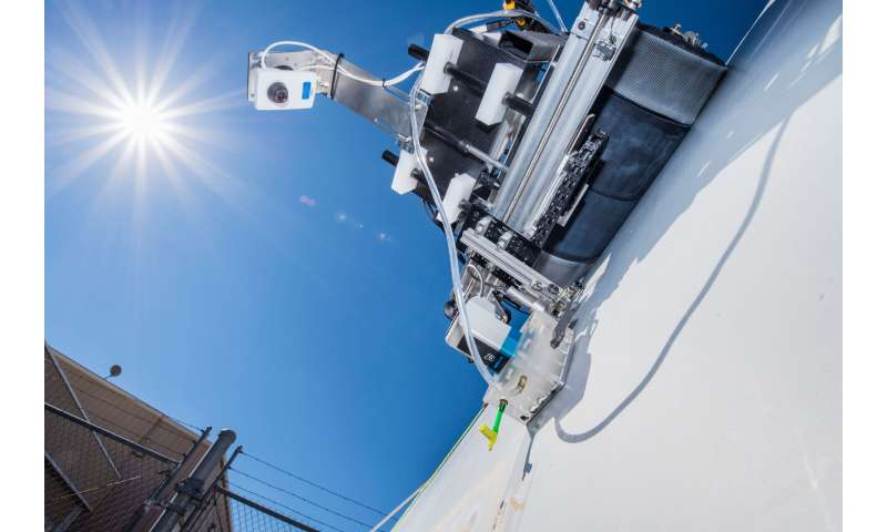 Sandia's crawling robots, drones detect damage to save wind blades