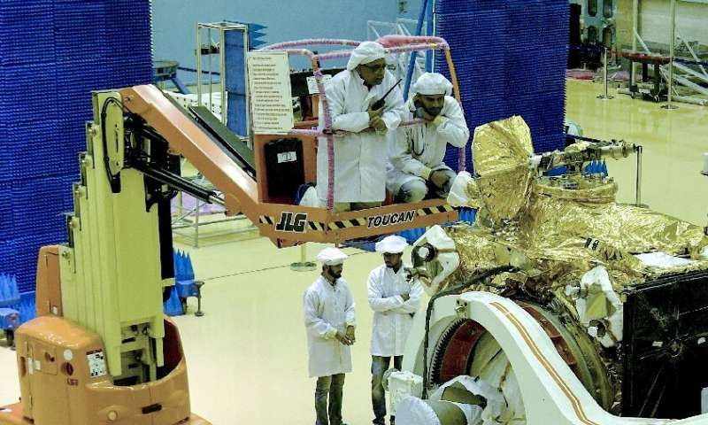 Scientists work on the orbiter vehicle of India's first moon lander