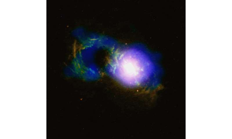 SDSS J1430+1339: Storm rages in cosmic teacup