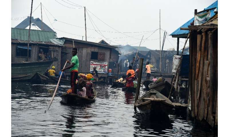 Several hundred thousand people live in Makoko—a floating slum that officially does not exist