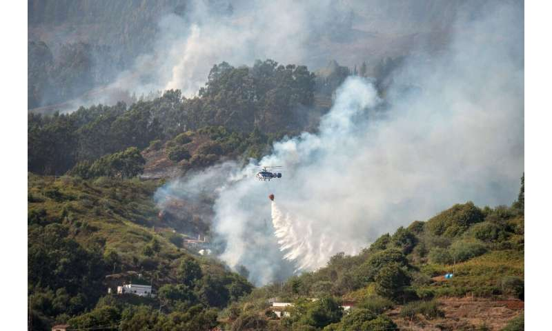 Some 700 firefighters and other crew backed by 16 water-dropping helicopters and planes were working on controlling the blaze