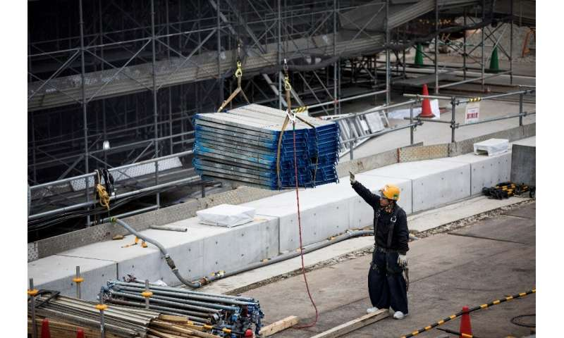 Some argue the city has kept on schedule at the cost of the health and safety of the workers building the sites