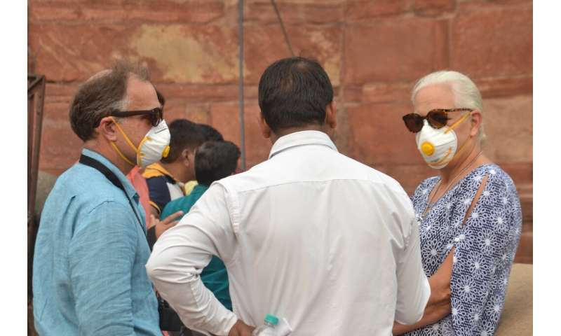 Some foreign tourists wore face masks while visiting the famed Taj Mahal in Agra as smog levels soared
