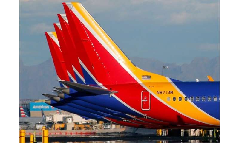 Southwest Airlines cut its first-quarter sales forecast, due in part to the hit from cancelled flights following the Boeing 737