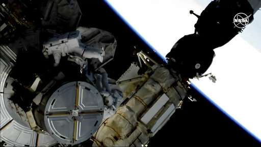 Spacewalking astronauts swap out space station's batteries