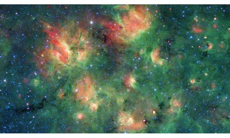Spitzer spots a starry region bursting with bubbles