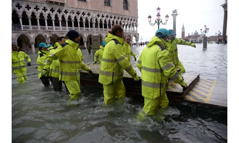 St Mark's Square had been shut for several hours on Friday as strong storms and winds battered the region