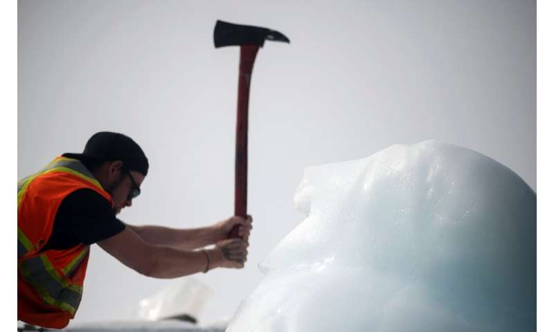 Taylor Lindsorn chops blocks off an iceberg with an ax—the tools of the trade have hardly changed over the years