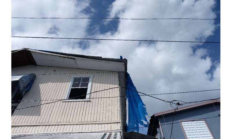 The blue tarp that was used to protect the roof damaged by Hurricane Maria two years ago is showing wear and tear in Catano, Pue