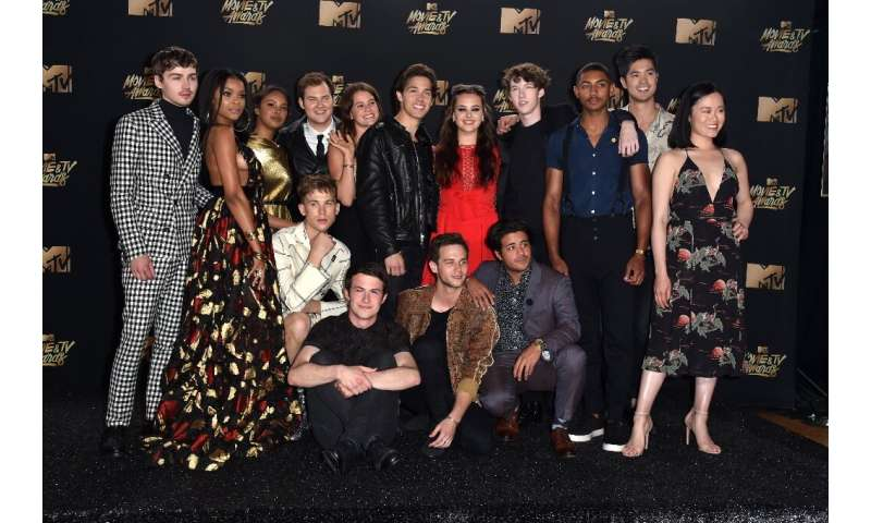 The cast of '13 Reasons Why' poses in the press room during the 2017 MTV Movie And TV Awards