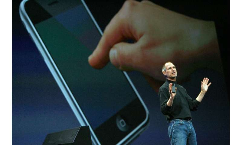 The collaboration of designer Jony Ive and the late Steve Jobs, seen at the 2007 launch of the iPhone, was essential to the tren