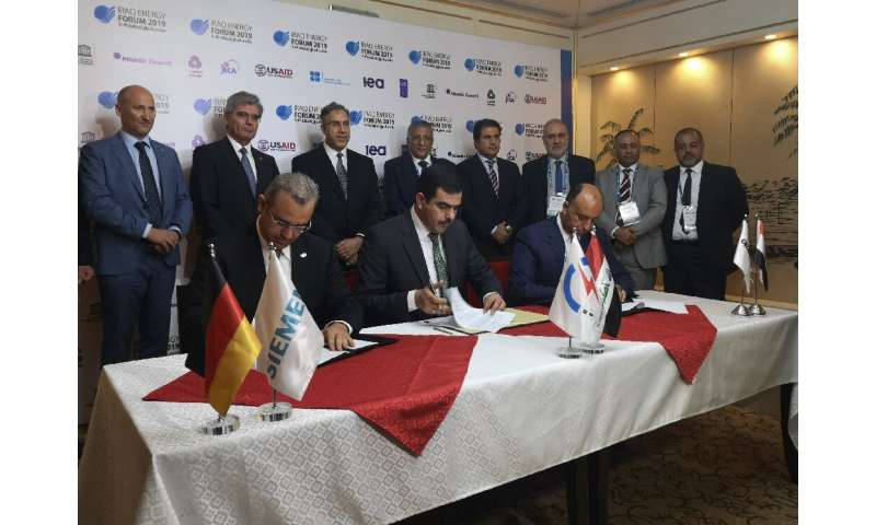 The deal signed Saturday aims to pump 1.7 gigawatts into Iraq's struggling energy grid