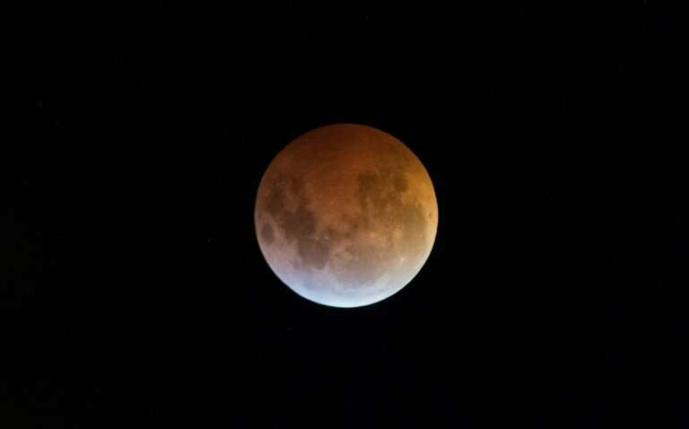The Earth's shadow almost totally obscures the view of the so-called Super Blood Wolf Moon during a total lunar eclipse