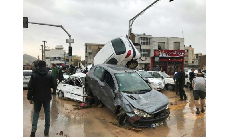 The floods blocked roads and destroyed cars