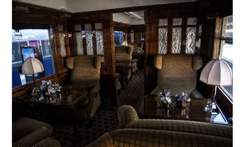 The grand interior of one of the restored carriages, complete with art deco fittings