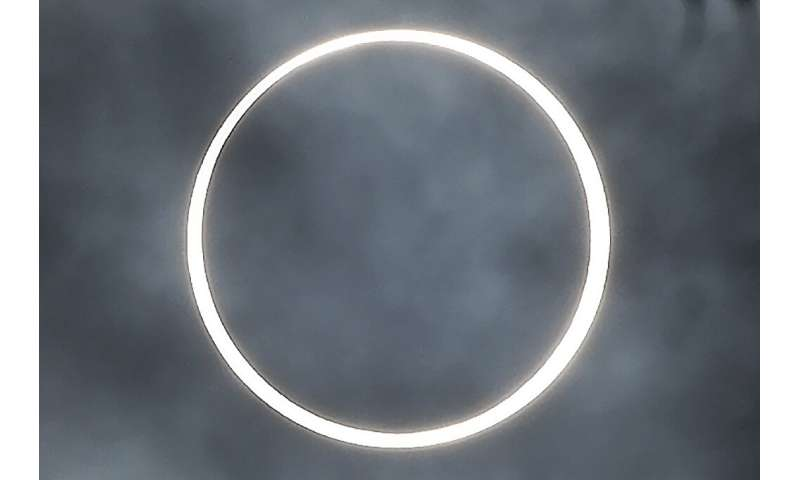 "The moon totally covers the sun in the rare ""ring of fire"" solar eclipse as seen from the south Indian city of Dindigu"