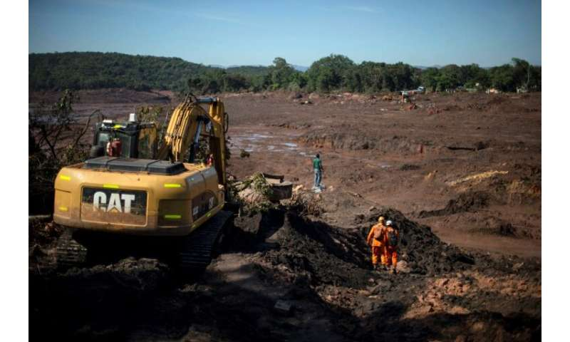The search goes on to recover the dozens of bodies still buried in the mineral-laced mud following the collapse of a dam in Braz