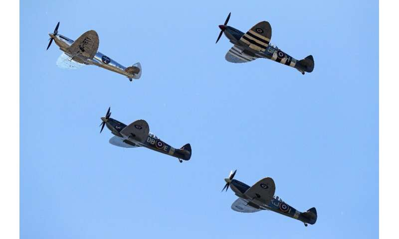 The Silver Spitfire was accompanied by three other surviving Spitfires in their regulation military green colours