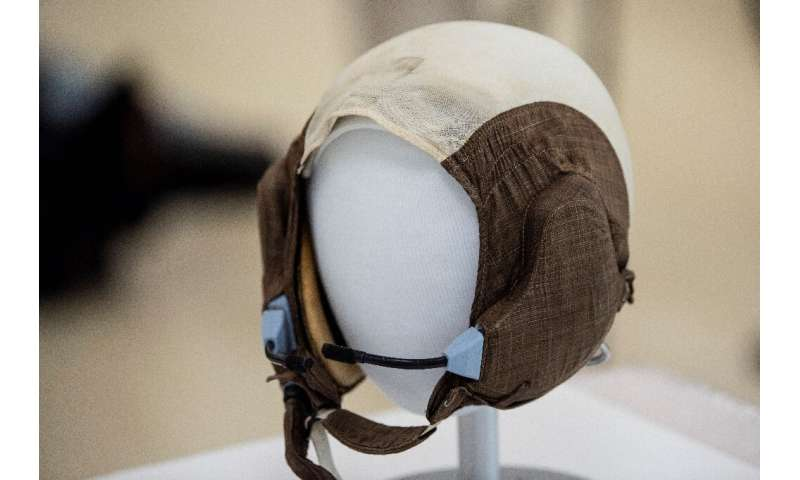 "The slightly yellowed ""Snoopy Cap"" (formally known as a ""communications carrier"") worn by Apollo 11 crew mem"