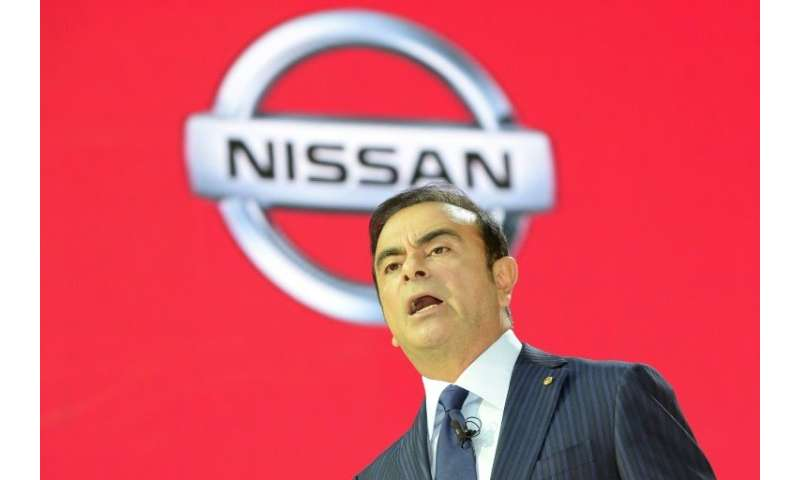 The then Nissan Motor president Carlos Ghosn speaking to reporters in 2013