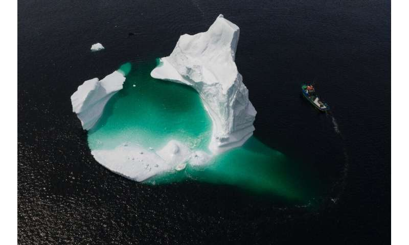 """This aerial photo shows Edward Kean's boat passing an iceberg in Bonavista Bay—it's a difficult task to break up and """"harve"""