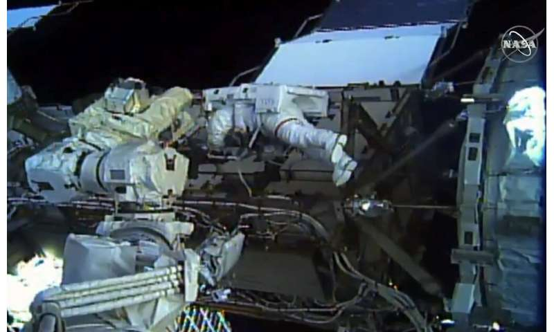 This image taken from NASA TV shows astronaut Christina Koch during a spacewalk outside the International Space Station on Octob