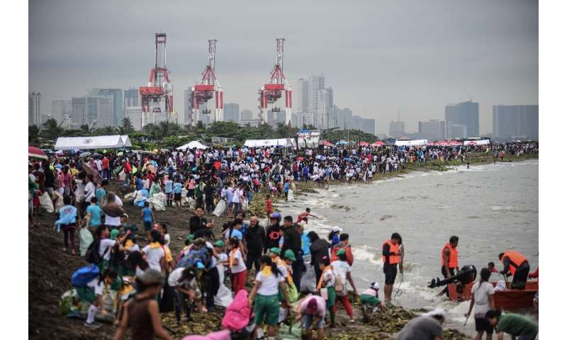 Thousands turned out in Philippines to scour heavily polluted Manila Bay for trash