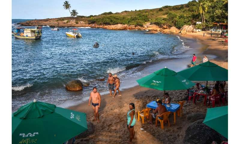 Tourists are seen on Calhetas beach in Pernambuco state in October 2019